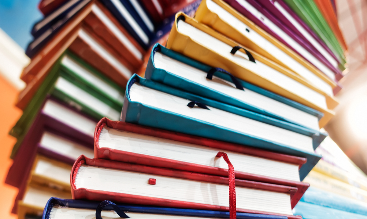 Stacks of different colored books
