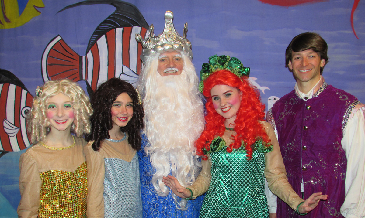 Cast of Little Mermaid at Marquis Theatre pose for a photo