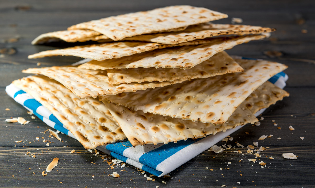 Pieces of Matzo on a blue and white napkin