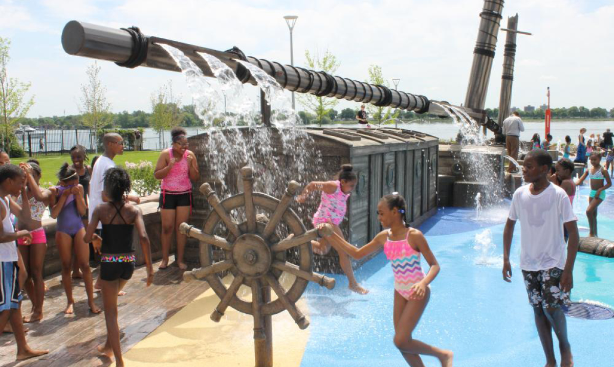 Kids playing on the schooner-themed splash park in Detroit