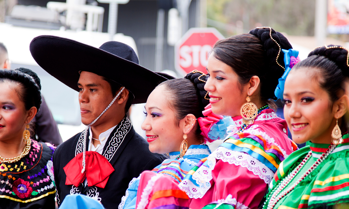 Five performers pose for the camera during a Cinco de Mayo Celebration