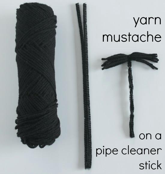 Yarn mustache on a stick