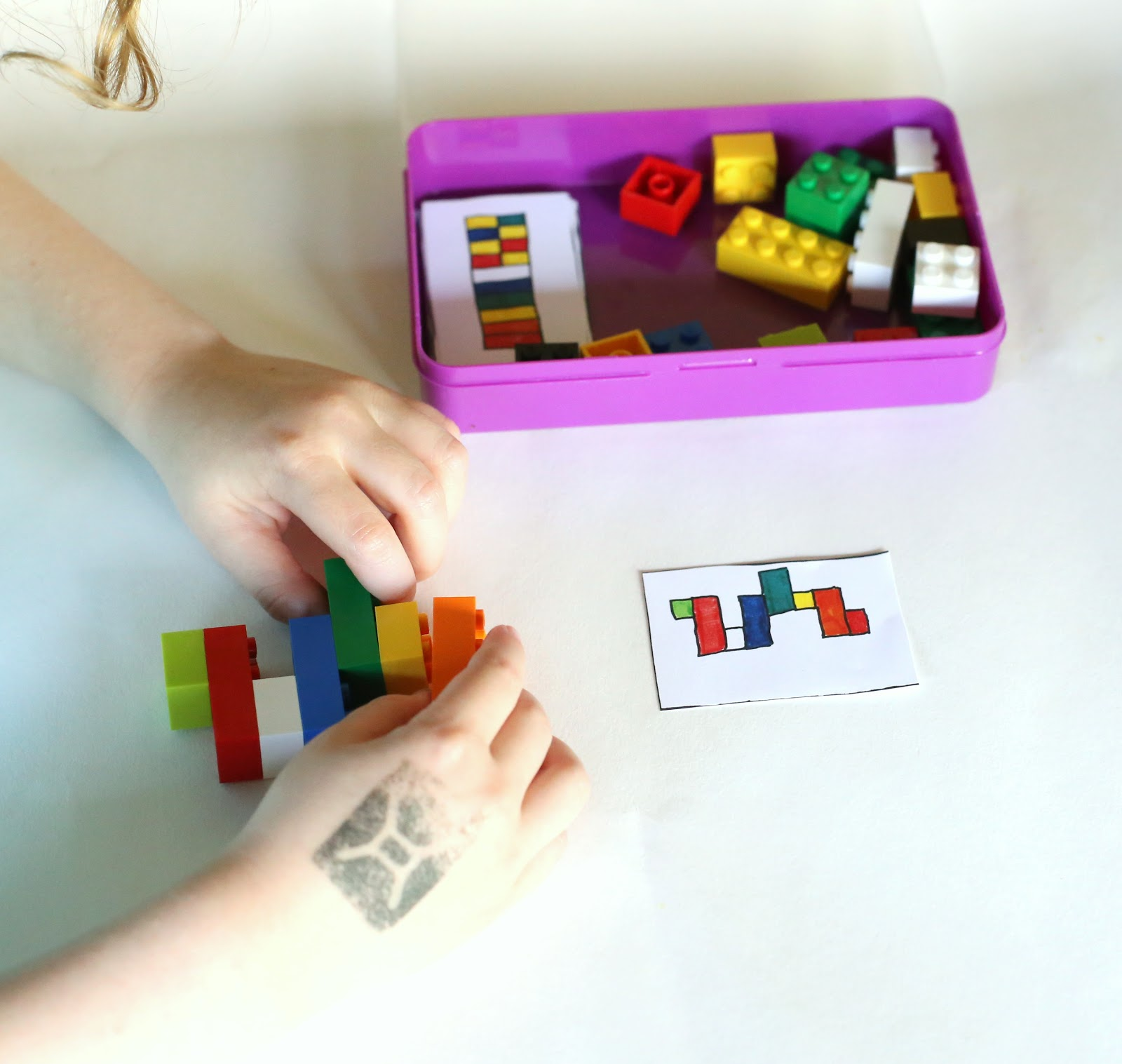 Kid playing with a portable lego kit