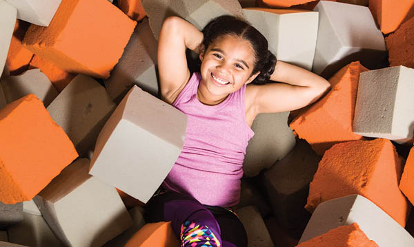 Child smiling in foam pit