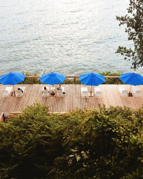 Beach chairs on a dock near a lake
