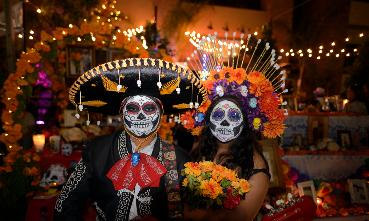 two people in day of the dead costume