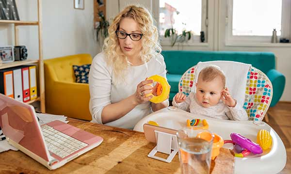 Mom working at home with baby