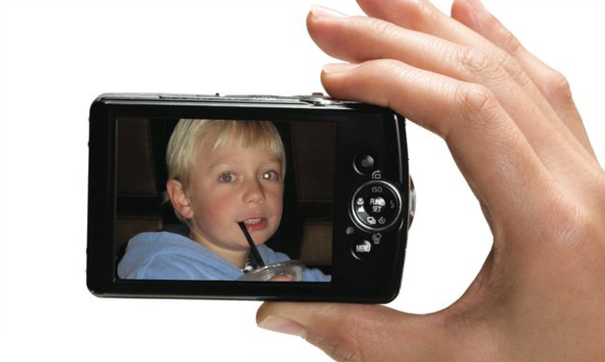 Photo of boy inside a camera with a gold glow in eye