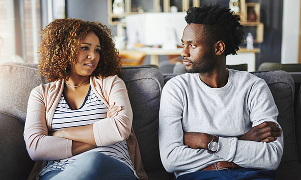 Couple looking at one another angrily