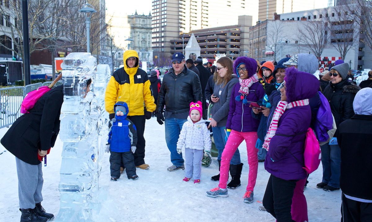 Kids looking at an ice sculpture at Winter Blast