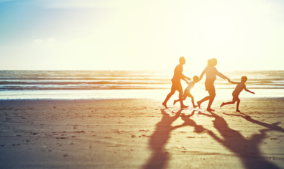 Silhouette of a family of four on a beach