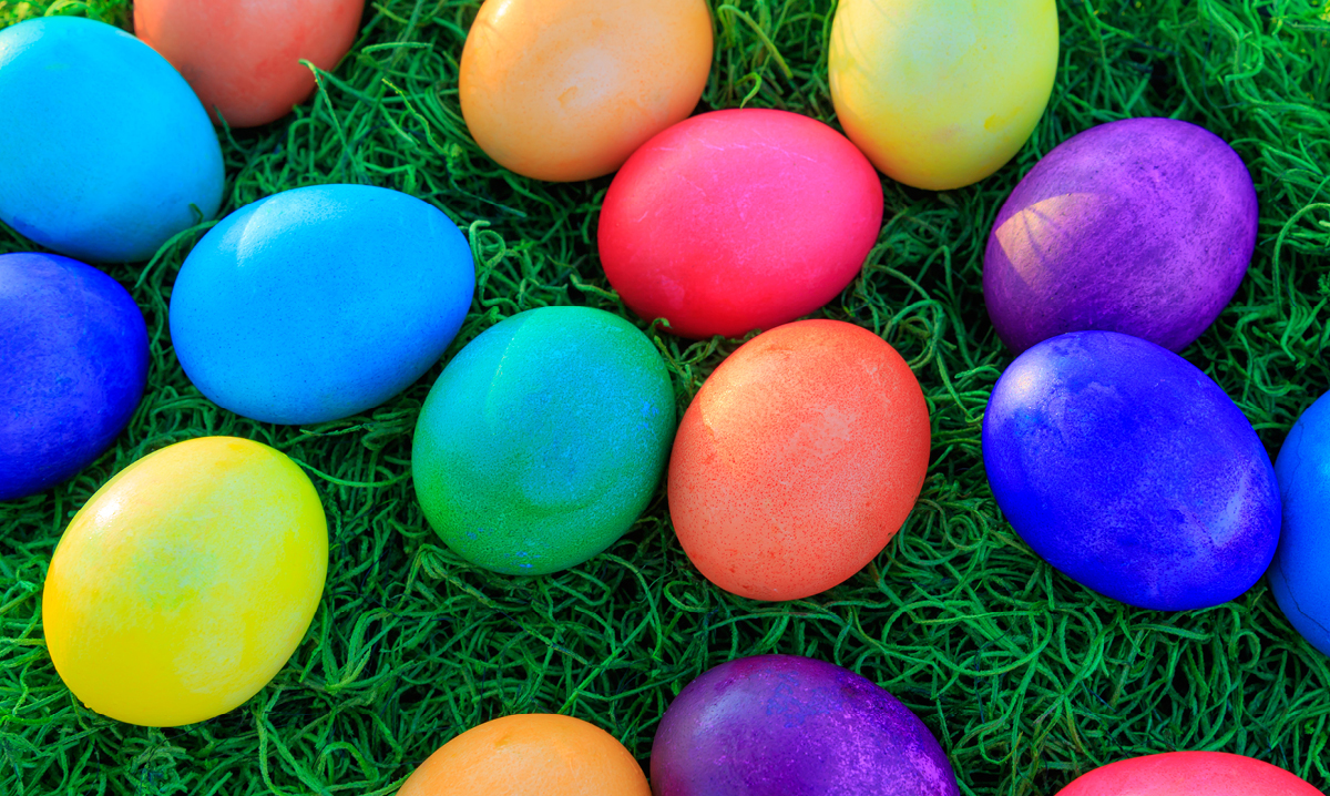 Color full easter eggs lying in the grass