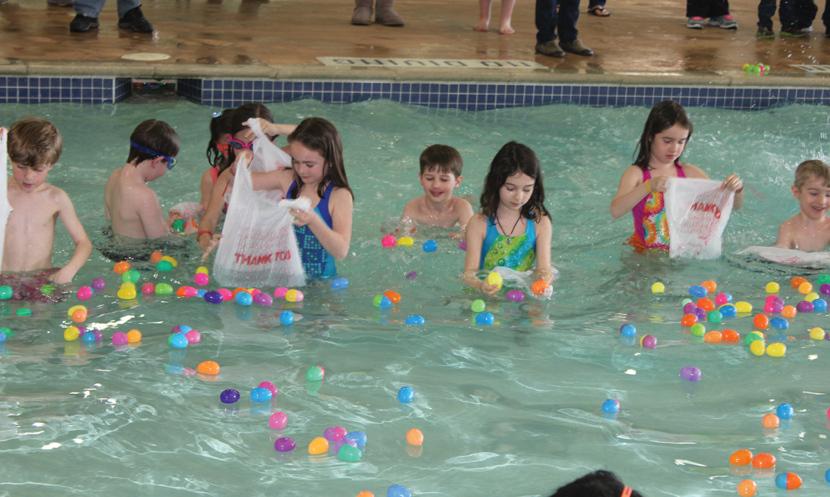 Kids hunting for eggs in a pool during Saline's Springfest