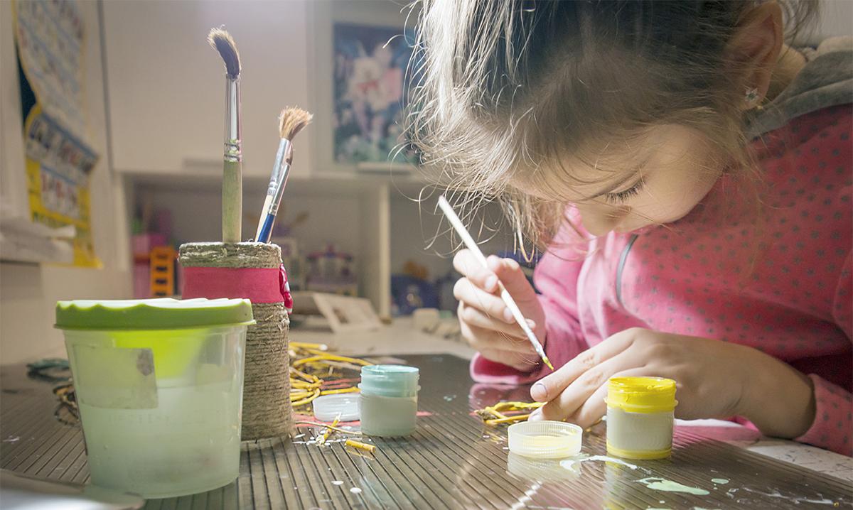 Girl painting in an art studio