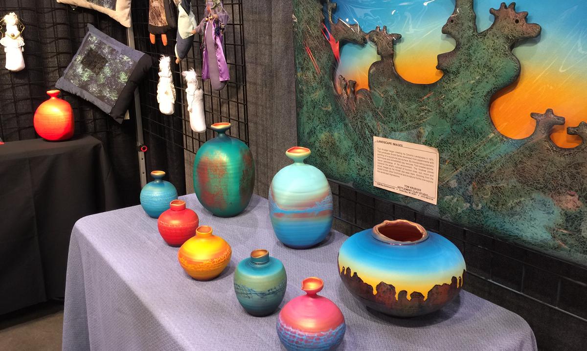 Colorful handmade pots on display