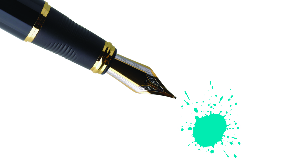 A black ink pen with a spot of teal ink on a white background