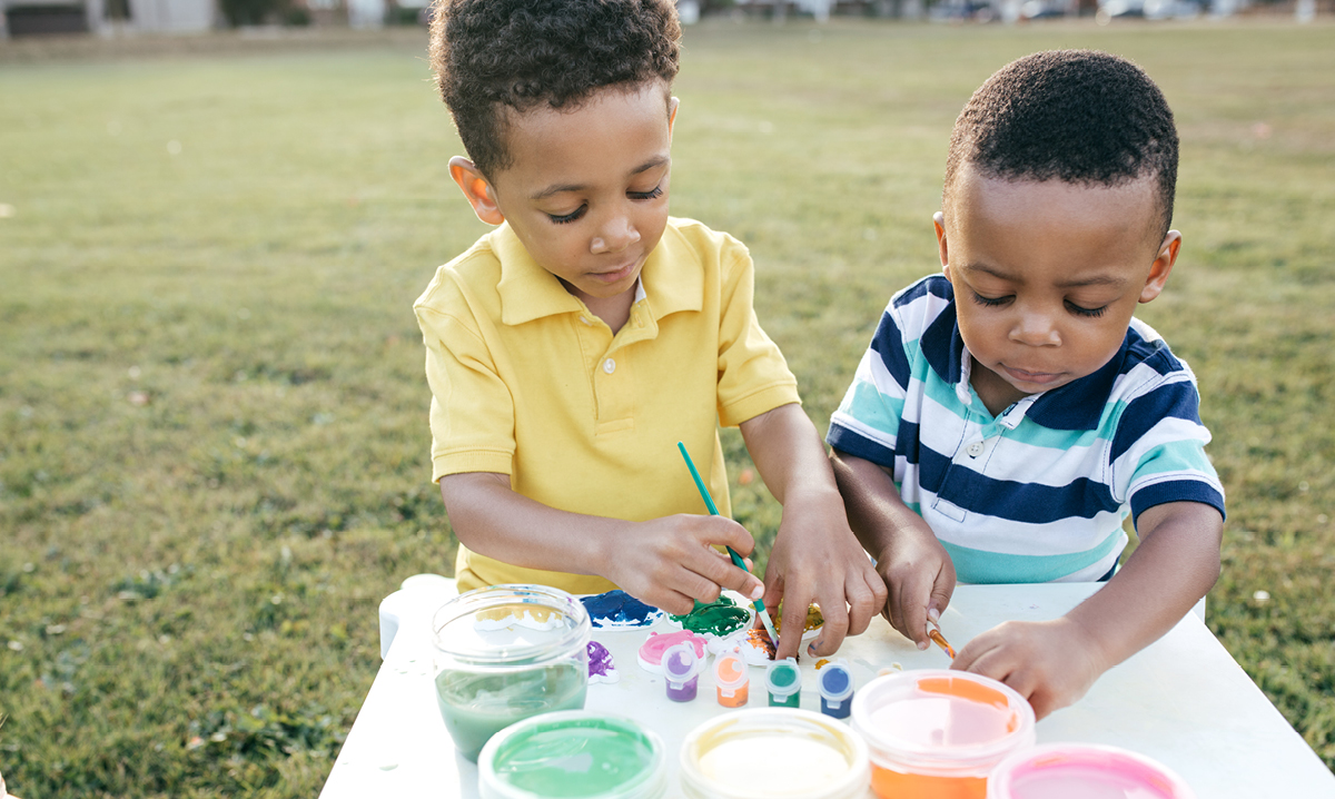 Two toddlers doing arts and crafts