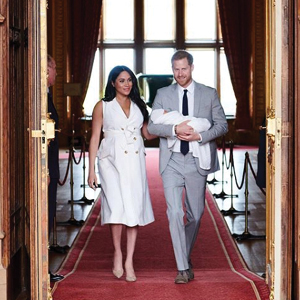 Prince Harry and Megan Markle with their new baby