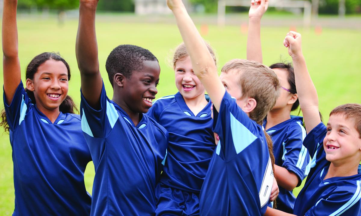 A kids soccer team celebrates