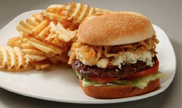 Slider hamburger with chips on a plate