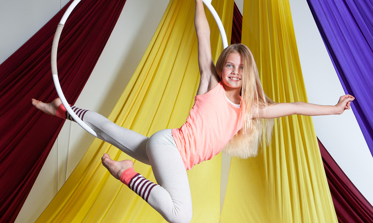 Tween girl doing aerial gymnastics