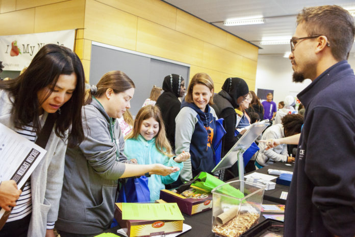 Attendees visit tables at the Education Expo on Sept. 30 at Cranbrook Institute of Science.
