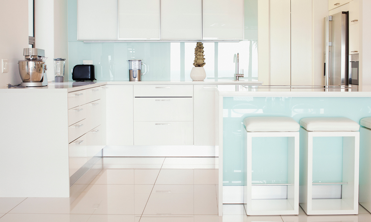 An organized white and light blue kitchen