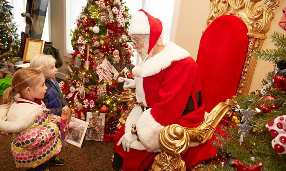 Little girls looking at Santa