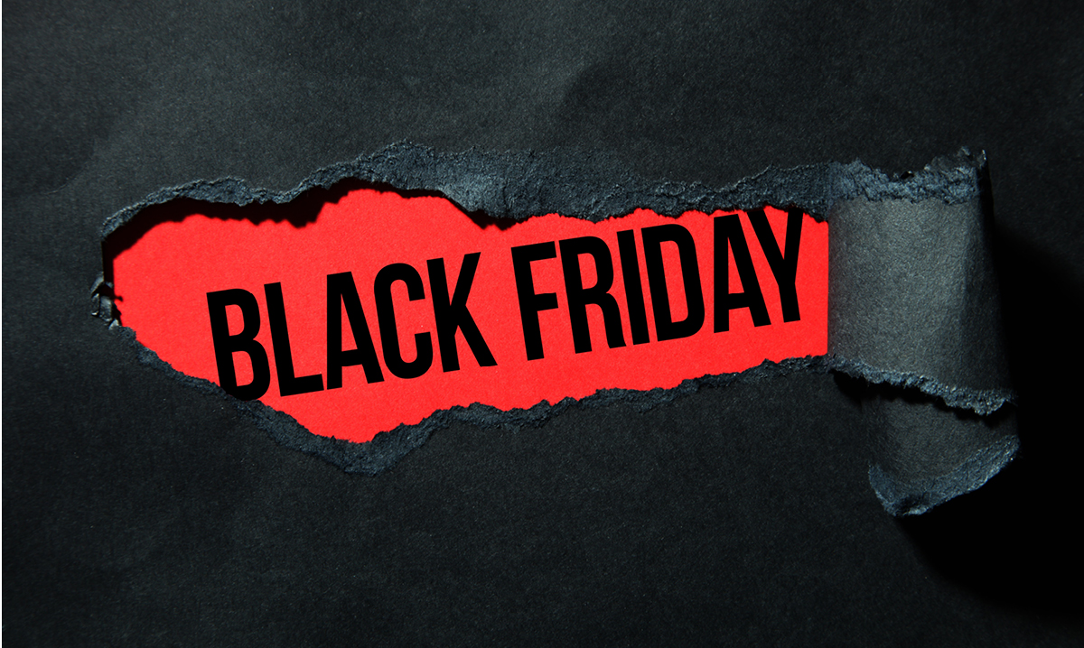 Black Friday on a red background with black paper peeling away