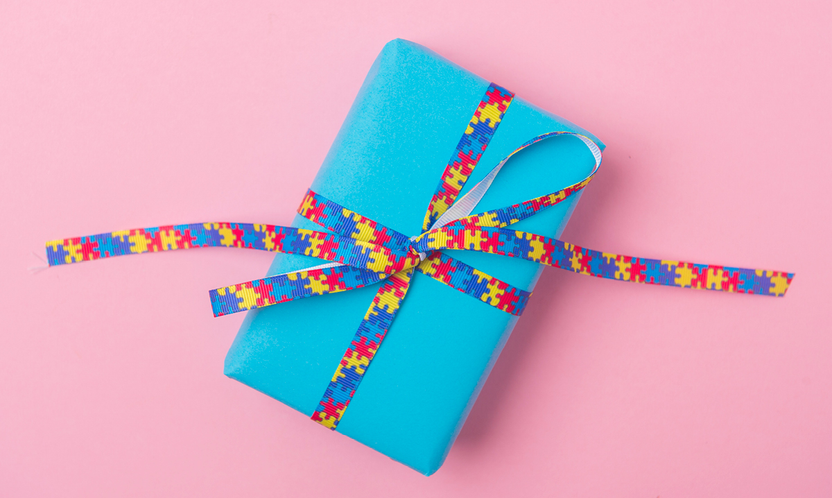 A blue gift on a pink background