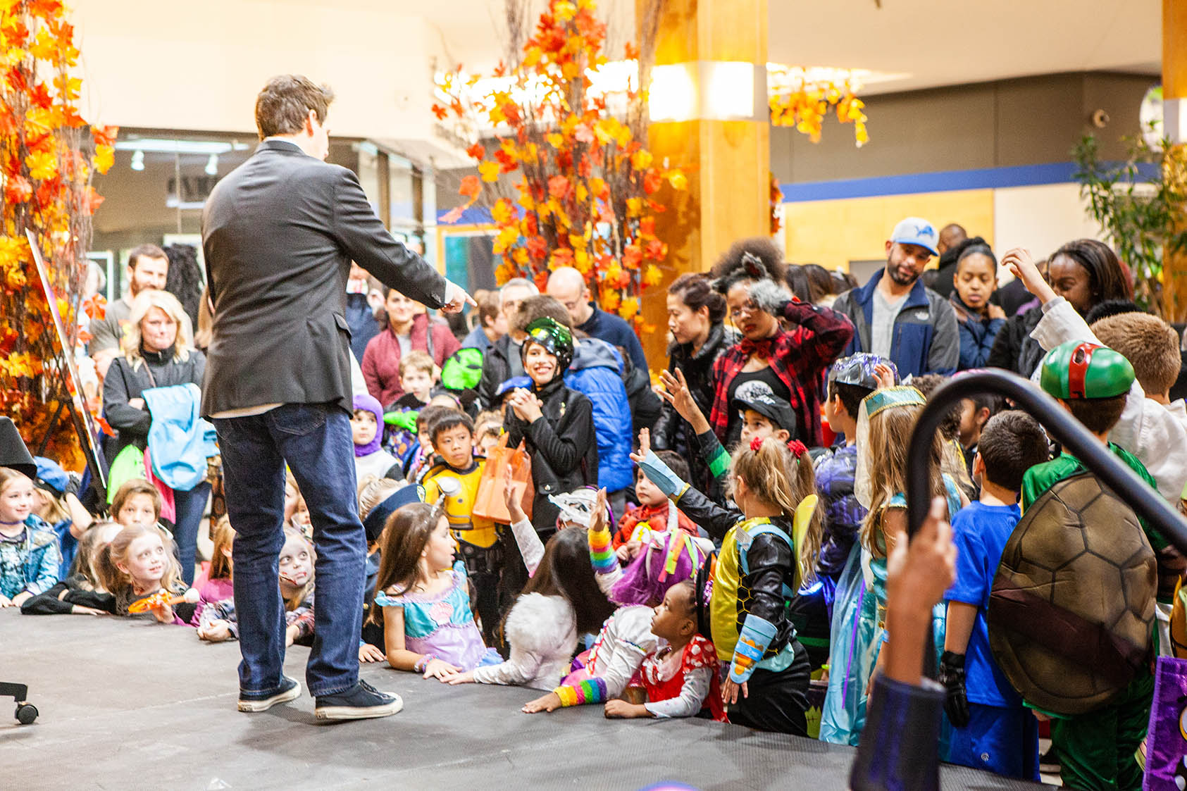 Monster Mash attendees watch Jasen Magic at Orchard Mall on Oct. 26, 2018.