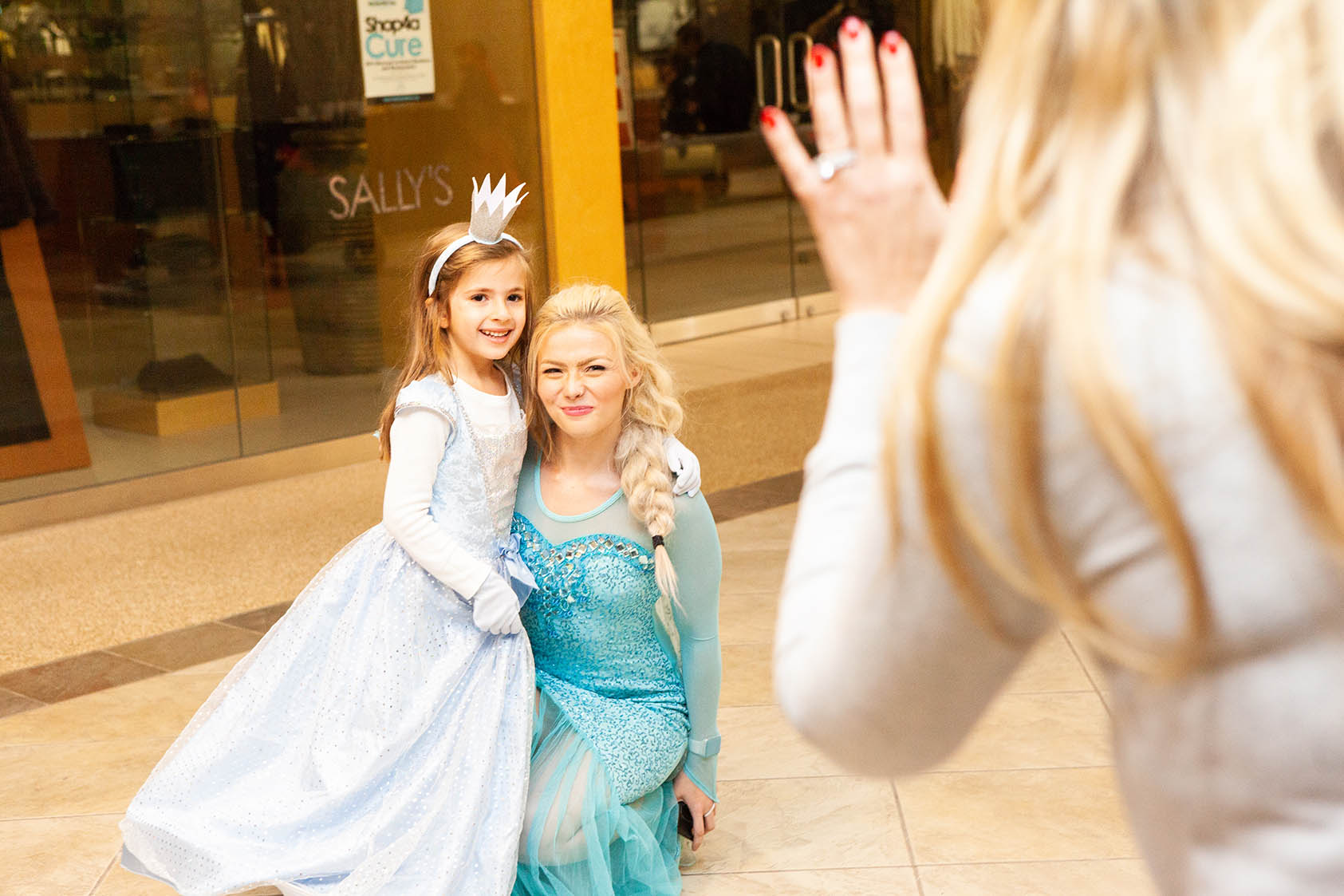 "Monster Mash attendee takes picture with Metro Parent's ""Elsa"" at Orchard Mall on Oct. 26, 2018."