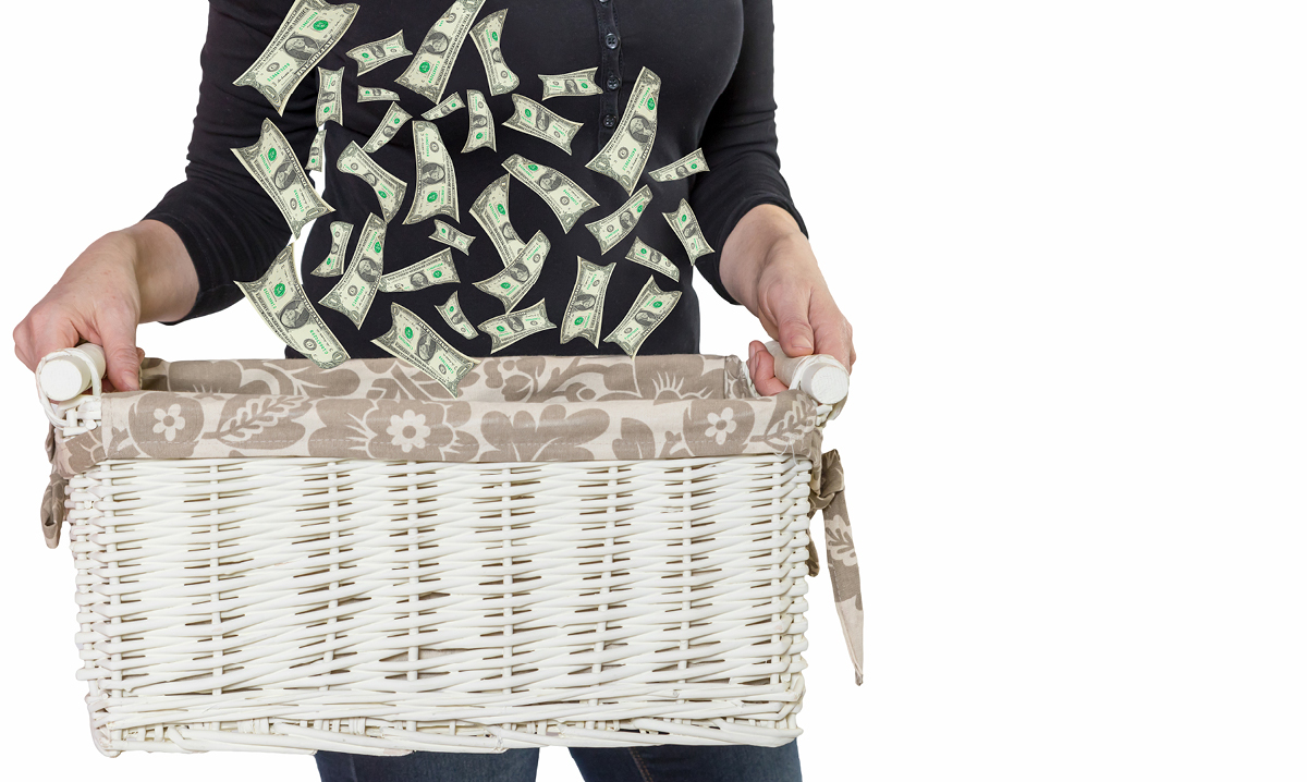 Woman holding a basket with money falling into it