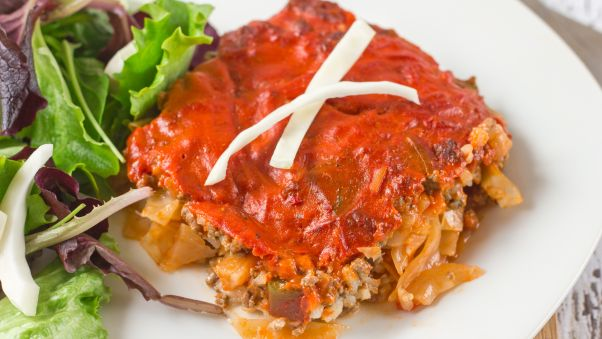 Cabbage beef casserole on a white plate