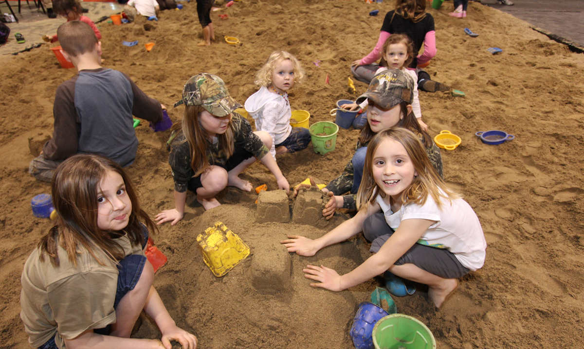 Kids playing in the sandbox at Outdoorama