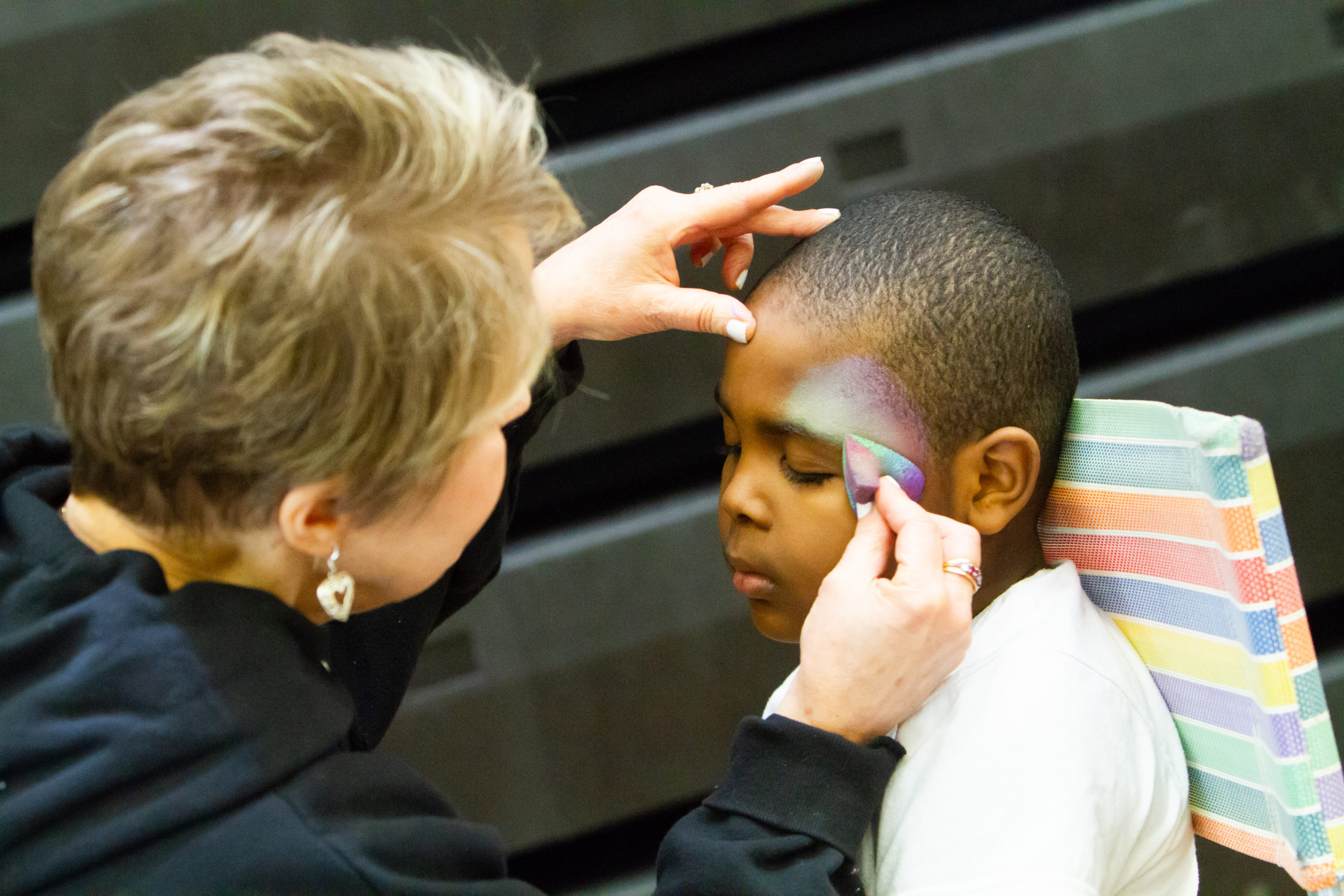 Child getting face painted at Camp Expo 2019.