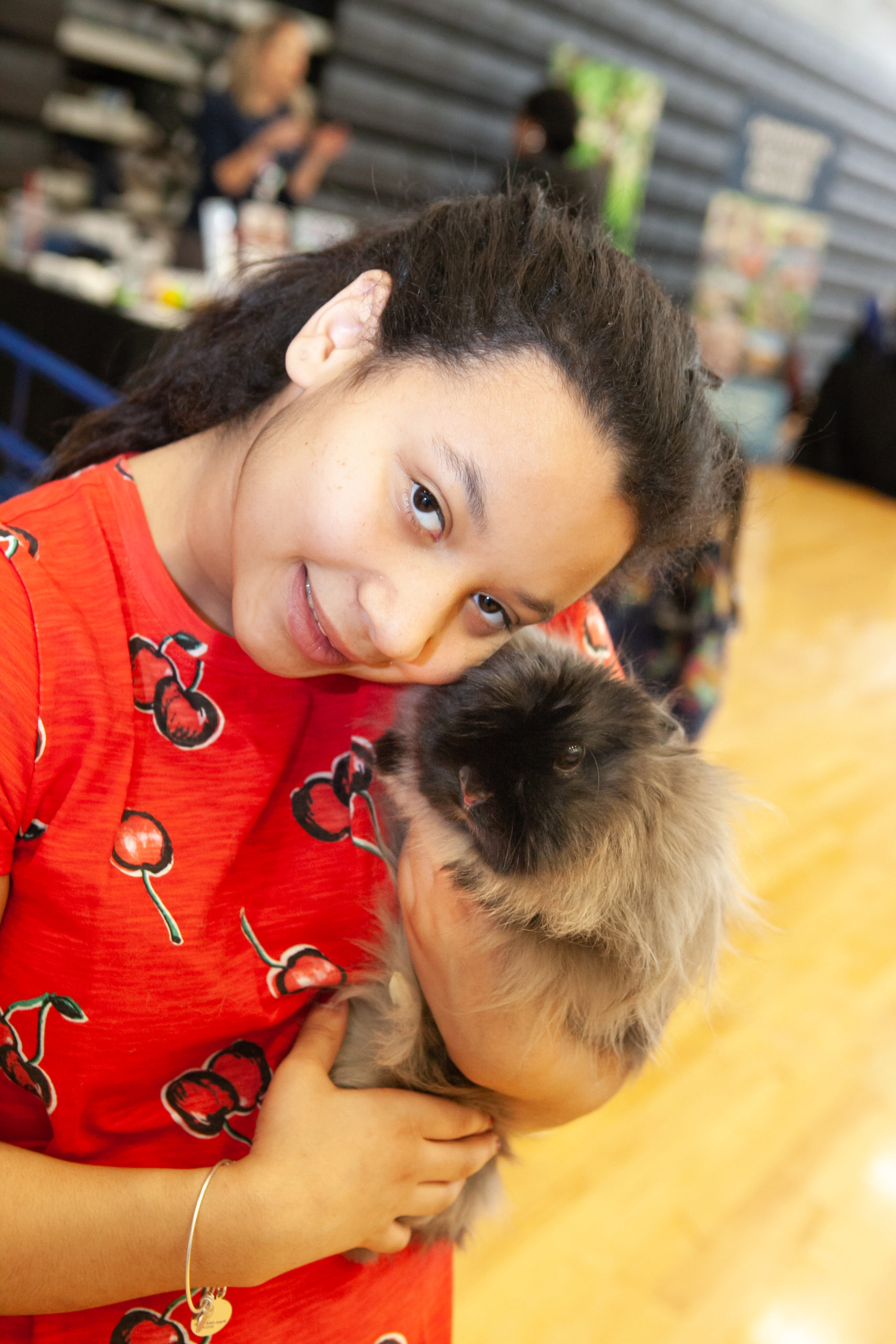 Girl holding bunny at Camp Expo 2019.