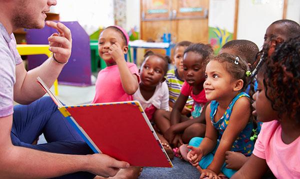 Kids being read a book