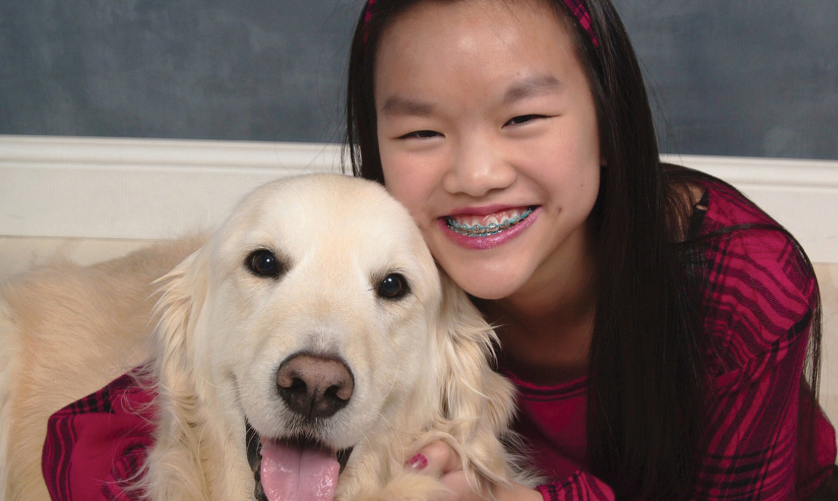 Macomb teen Delaney Kraemer poses with a dog