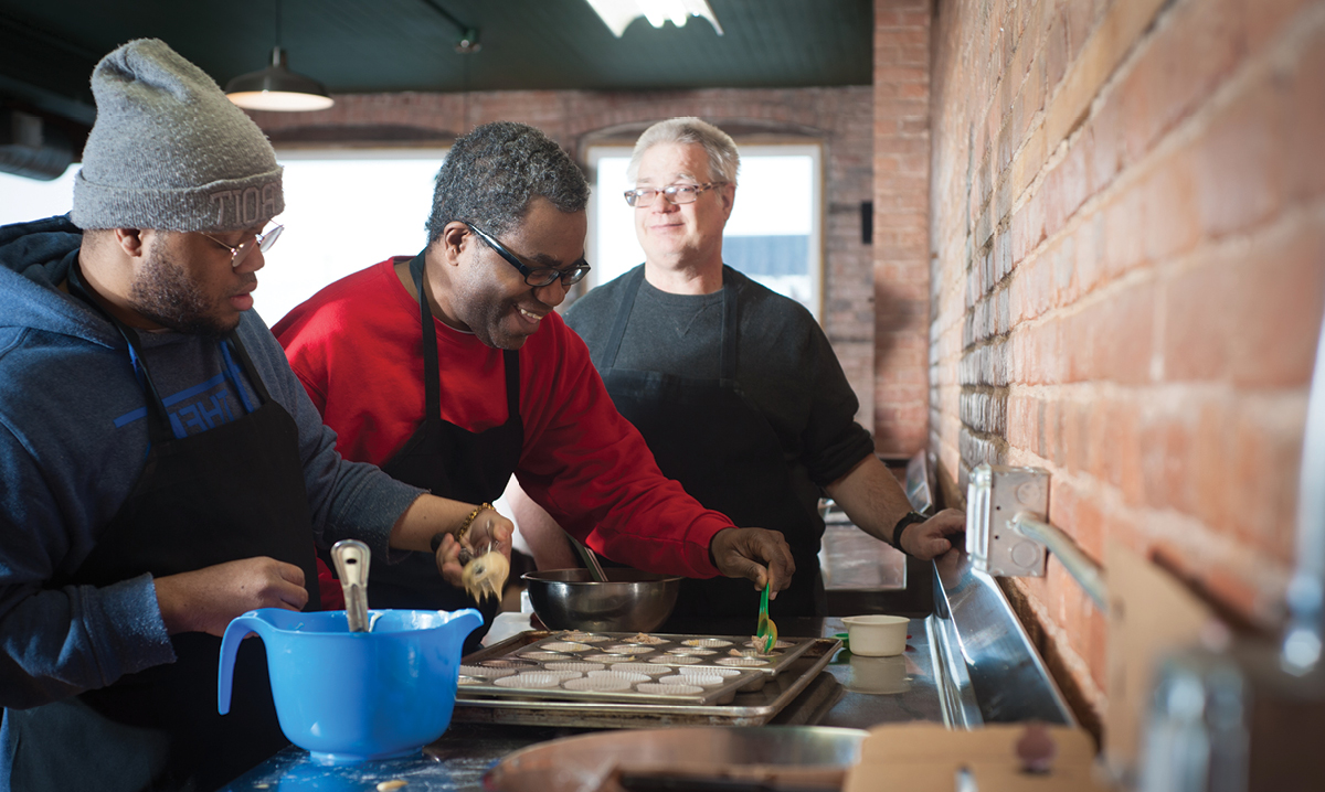 People with special needs cooking food