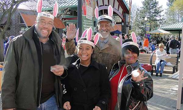 A family in bunny ears posing for a picture during the Bunnyville event