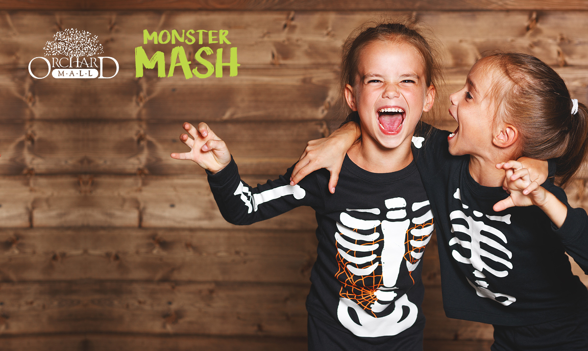 Two kids dressed up as skeletons for Halloween