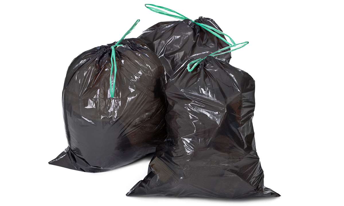 Three tied garbage bags on a white background