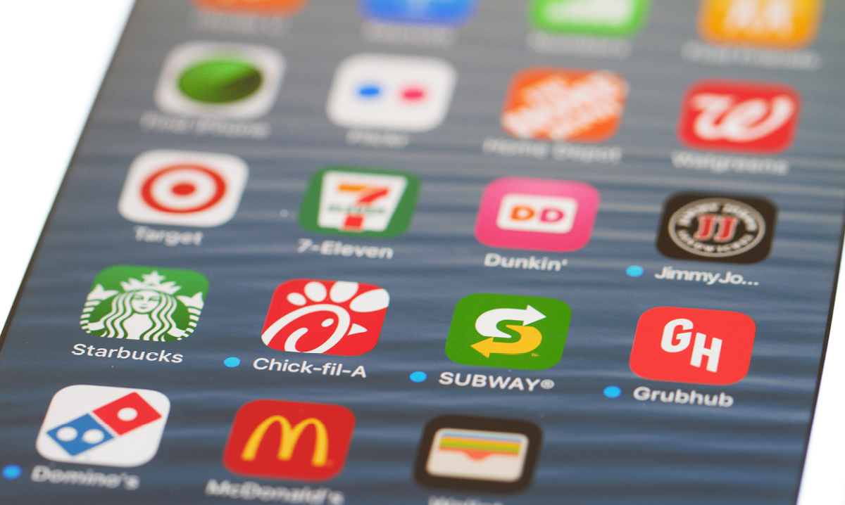Smartphone showing various food delivery apps