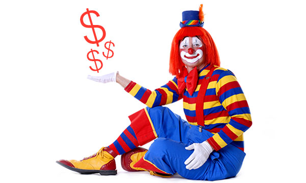 Clown holding red money signs on a white background