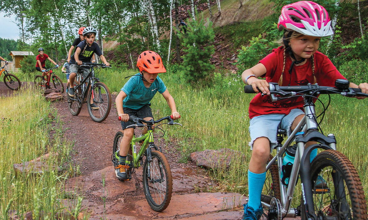Kids riding bikes in the Cuyuna Country State Recreation Area