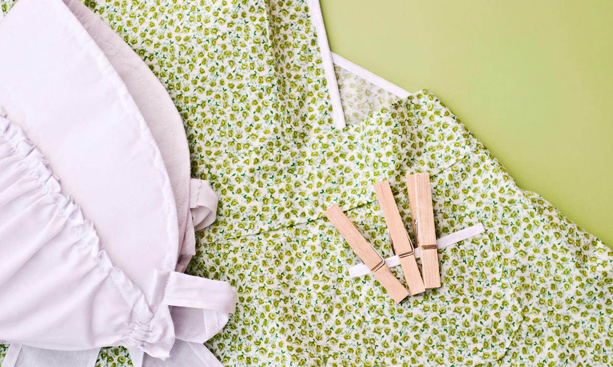 Clothespin and a bonnet on a green floral dress