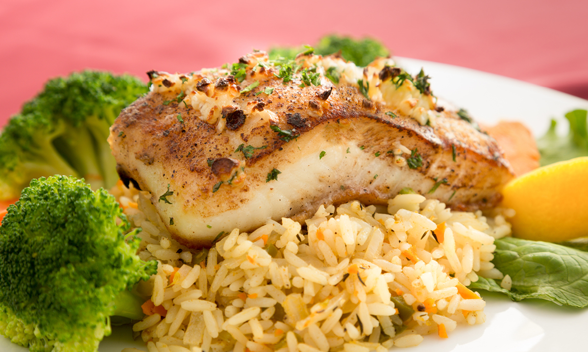 Halibut on rice with broccoli and vegetables