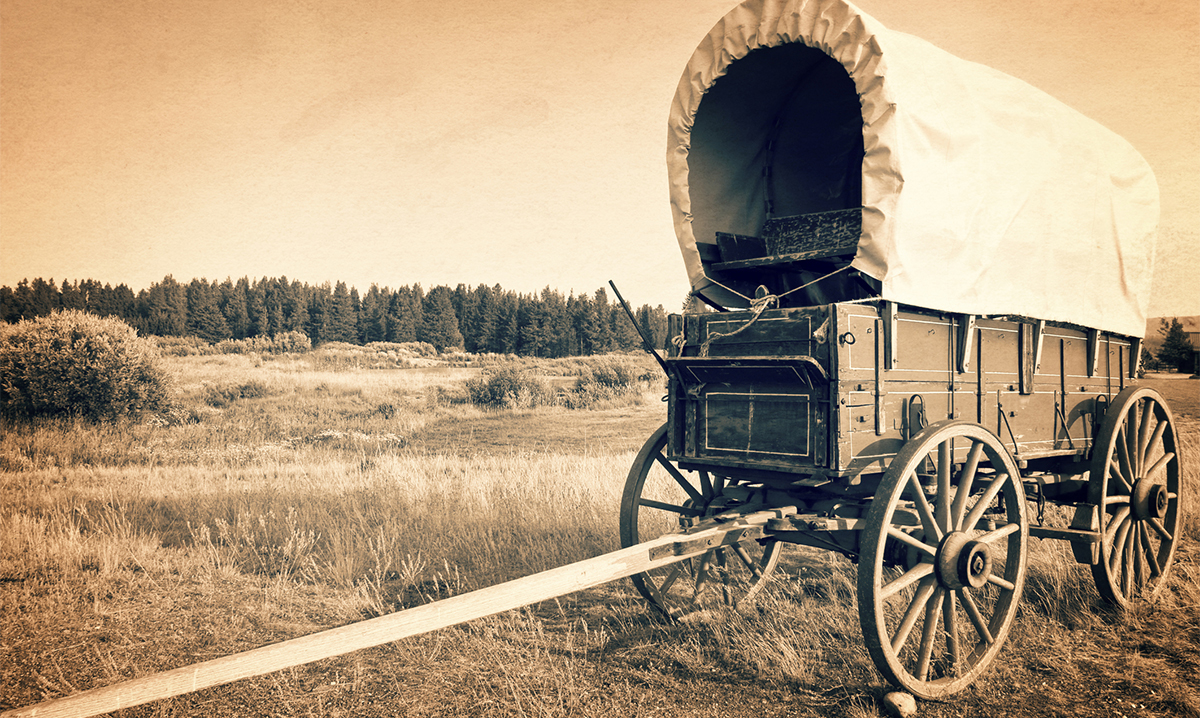A vintage American western wagon in sepia
