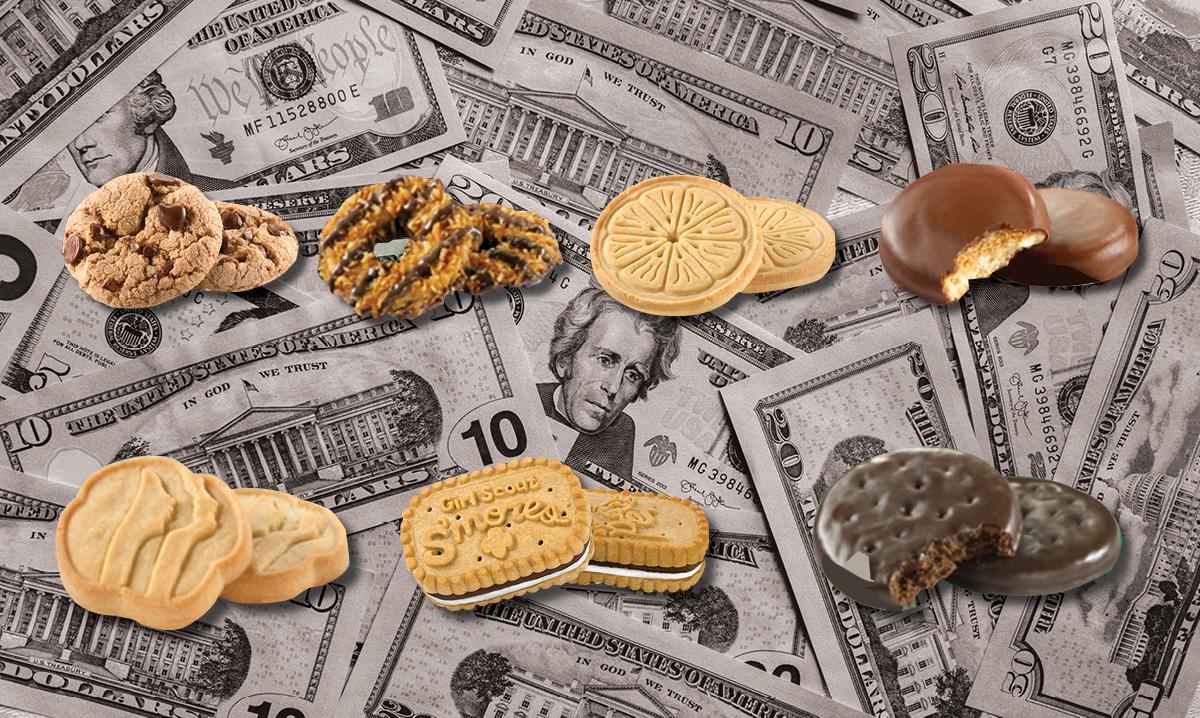 Stacks of Girl Scout cookies on money bills